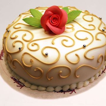 Afbeeldingen van Goud gouden swirl taart